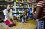 """TO GO WITH AFP STORY BY SUSAN NJANJI (FILES) This file photo taken on November 14, 2015 shows twelve-year-old South African Kyle Todd (L) receiving instructions before his initiation ceremony to become a Sangoma or traditional healer at a traditional healer school in Pretoria, South Africa. Kyle officiates as """"sangoma"""", a medium and traditional healer in South Africa which is extremely rare for a white man in this country. South African traditional healers are practitioners of traditional African medicine in Southern Africa. They fulfill different social and political roles in the community, including divination, healing physical, emotional and spiritual illnesses, directing birth or death rituals, finding lost cattle, protecting warriors, counteracting witches, and narrating the history, cosmology, and myths of their tradition. / AFP / MUJAHID SAFODIEN"""