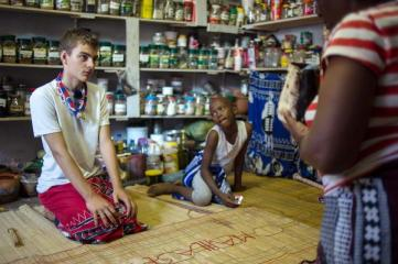"TO GO WITH AFP STORY BY SUSAN NJANJI (FILES) This file photo taken on November 14, 2015 shows twelve-year-old South African Kyle Todd (L) receiving instructions before his initiation ceremony to become a Sangoma or traditional healer at a traditional healer school in Pretoria, South Africa. Kyle officiates as ""sangoma"", a medium and traditional healer in South Africa which is extremely rare for a white man in this country. South African traditional healers are practitioners of traditional African medicine in Southern Africa. They fulfill different social and political roles in the community, including divination, healing physical, emotional and spiritual illnesses, directing birth or death rituals, finding lost cattle, protecting warriors, counteracting witches, and narrating the history, cosmology, and myths of their tradition. / AFP / MUJAHID SAFODIEN"