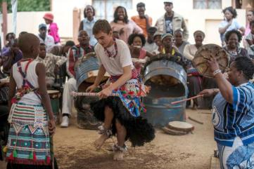 "TO GO WITH AFP STORY BY SUSAN NJANJI (FILES) This file photo taken on November 14, 2015 shows twelve-year-old South African Kyle Todd (C) dancing during his initiation ceremony to become a Sangoma or traditional healer at a traditional healer school in Pretoria, South Africa. Kyle officiates as ""sangoma"", a medium and traditional healer in South Africa which is extremely rare for a white man in this country. South African traditional healers are practitioners of traditional African medicine in Southern Africa. They fulfill different social and political roles in the community, including divination, healing physical, emotional and spiritual illnesses, directing birth or death rituals, finding lost cattle, protecting warriors, counteracting witches, and narrating the history, cosmology, and myths of their tradition. / AFP / MUJAHID SAFODIEN"